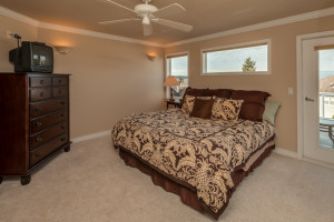 Main floor master en suite bedroom with huge walk-in closet and its own views and deck access.