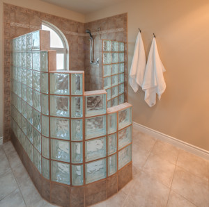 Master bath extends and captures the light.