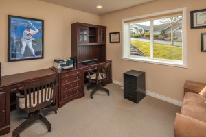 Roomy office with French doors opening onto 2nd level family room.