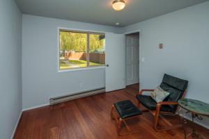 Main floor bedroom or office with garden view.